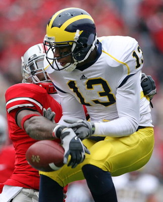 COLUMBUS, OH - NOVEMBER 22:  Greg Mathews #13 of the Michigan Wolverines  has a pass knocked away by Malcolm Jenkins #2 of the Ohio State Buckeyes during the Big Ten Conference game at Ohio Stadium on November 22, 2008 in Columbus, Ohio.  (Photo by Andy L
