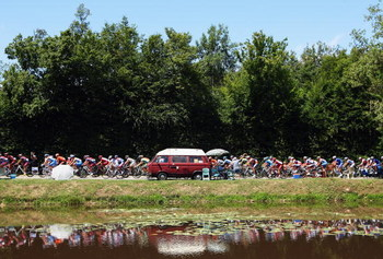 AUBENAS, FRANCE - JULY 24:  The peloton ride past a lake during stage 19 of the 2009 Tour de France from Bourgoin-Jallieu to Aubenas on July 24, 2009 in Aubenas, France.  (Photo by Bryn Lennon/Getty Images)