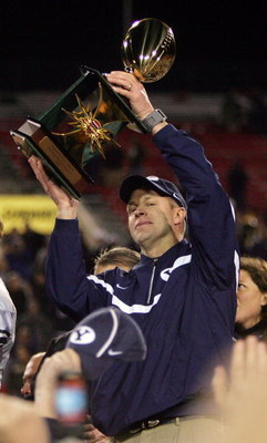 LAS VEGAS - DECEMBER 21:  Brigham Young University Cougar head coach Bronco Mendenhall celebrates with the game trophy after defeating the Oregon Ducks 38-8 in the Pioneer PureVision Las Vegas Bowl at Sam Boyd Stadium December 21, 2006 in Las Vegas, Nevad