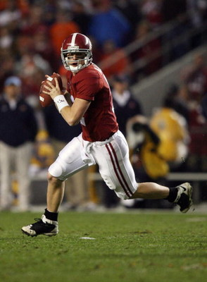 TUSCALOOSA, AL - NOVEMBER 29:  Quarterback Greg McElroy #12 of the Alabama Crimson Tide rolls out to pass against the Auburn Tigers at Bryant-Denny Stadium on November 29, 2008 in Tuscaloosa, Alabama. Alabama defeated Auburn 36-0.  (Photo by Doug Benc/Get