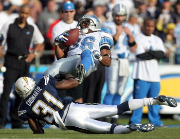 SAN DIEGO - DECEMBER 16:  Aveion Cason #36 of the Detroit Lions is tackled by Antonio Cromartie #31 of the San Diego Chargers during the first quarter at Qualcomm Stadium December 16, 2007 in San Diego California.  (Photo by Harry How/Getty Images)