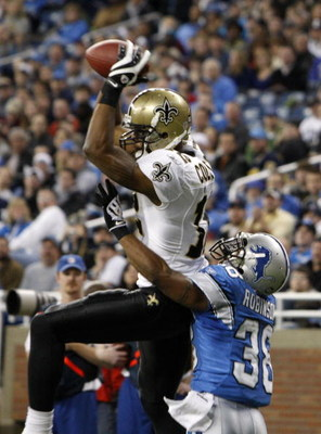 DETROIT - DECEMBER 21:  Wide receiver Marques Colston #12 of the New Orleans Saints scores on a six yard pass in the third quarter as Detroit Lions cornerback Ramzee Robinson #38 attempts to defend on December 21, 2008 at Ford Field in Detroit, Michigan.