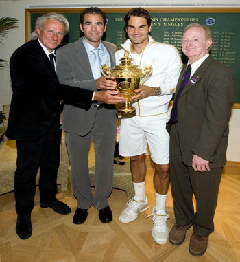 WIMBLEDON, ENGLAND - JULY 05:  Roger Federer of Switzerland (2R) celebrates with the trophy alongside Bjorn Borg (L), Pete Sampras (2L) and Rod Laver (R)  after the men's singles final match against Andy Roddick of USA on Day Thirteen of the Wimbledon Law