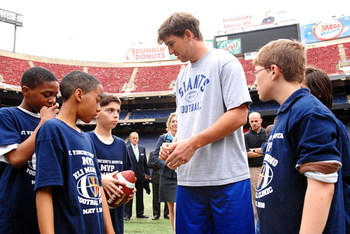 EAST RUTHERFORD, NJ - MAY 15:  Eli Manning of the New York Giants participates in a clinic sponsored by St Vincent's Hospital Manhattan at Giants Stadium on May 15, 2008 in East Rutherford, New Jersey  (Photo by Rob Loud/Getty Images for St. Vincent's Hos