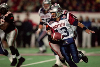 26 Nov 2000:  Anthony Calvillo #13 of the Montreal Alouettes runs with the ball during the Grey Cup 2000 game against the British Columbia Lions at the McMahon Stadium in Calgary, Alberta, Canada. The Lions defeated the Alouettes 28-26.Mandatory Credit: C