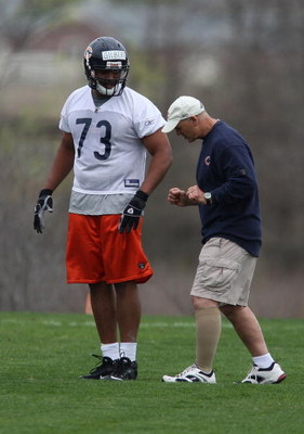 LAKE FOREST, IL - MAY 01: Defensive line coach Rob Marinelli of the Chicago Bears, former head coach of the Detroit Lions, works with Jarron Gilbert #73 during a rookie mini-camp practice on May 1, 2009 at Halas Hall in Lake Forest, Illinois. (Photo by Jo
