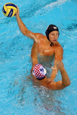 BEIJING - AUGUST 16:  Tony Azevedo of the United States passes over Aljosa Kunac of Croatia during their water polo match at the Ying Tung Natatorium on Day 8 of the Beijing 2008 Olympic Games on August 16, 2008 in Beijing, China.  (Photo by Clive Brunski