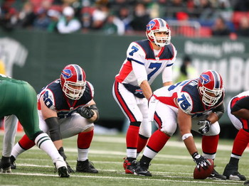 EAST RUTHERFORD, NJ - DECEMBER 14:  Brad Butler #60 and Duke Preston #75  of The Buffalo Bills pass block for JP Losman #7 against the New York Jets during their game on December 14, 2008 at Giants Stadium in East Rutherford, New Jersey.  (Photo by Al Bel