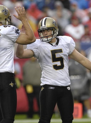 TAMPA, FL - NOVEMBER 30: Kicker Garrett Hartley #5 of the New Orleans Saints high fives after a conversion against the Tampa Bay Buccaneers at Raymond James Stadium on November 30, 2008 in Tampa, Florida.  (Photo by Al Messerschmidt/Getty Images)