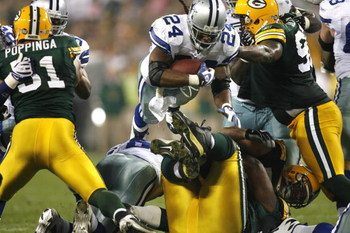 GREEN BAY - SEPTEMBER 21:  Marion Barber #24 of the Dallas Cowboys dives for a first down against the Green  Bay Packers during the first half of their game at Lambeau Field on September 21, 2008 in Green Bay, Wisconsin.  (Photo by Tom Hauck/Getty Images)