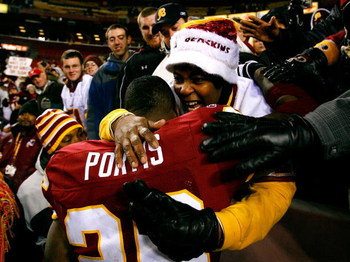 LANDOVER, MD - DECEMBER 21:  Running back Clinton Portis #26 of the Washington Redskins hugs his mom after defeating the Philadelphia Eagles 10-3 on December 21, 2008 at FedEx Field in Landover, Maryland.  (Photo by Kevin C. Cox/Getty Images)