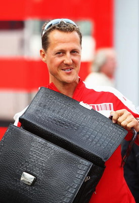 BARCELONA, SPAIN - MAY 09:  Former Ferrari F1 World Champion Michael Schumacher of Germany is seen in the paddock following qualifying for the Spanish Formula One Grand Prix at the Circuit de Catalunya on May 9, 2009 in Barcelona, Spain.  (Photo by Clive