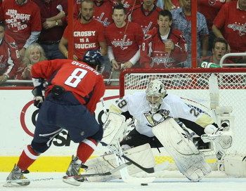 WASHINGTON - MAY 13: Alex Ovechkin #8 of the Washington Capitals is stopped by Marc-Andre Fleury #29 of the Pittsburgh Penguins during first period action in Game Seven of the Eastern Conference Semifinal  Round of the 2009 Stanley Cup Playoffs at Verizon