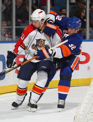UNIONDALE, NY - JANUARY 31: Richard Zednik #20 of the Florida Panthers is held by Brendan Witt #32 of the New York Islanders on January 31, 2009 at Nassau Coliseum in Uniondale, New York. (Photo by Bruce Bennett/Getty Images)