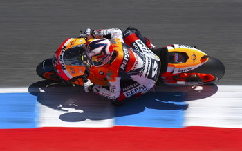 MONTEREY, CA - JULY 4:  Andrea Dovizioso of Italy rides the #4 Repsol Honda during qualifying for the Moto GP Red Bull U. S. Grand Prix at the Mazda Raceway Laguna Seca on July 4, 2009 in Monterey, California.  (Photo by Robert Laberge/Getty Images)