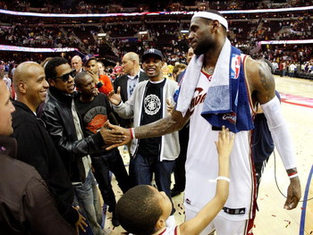 CLEVELAND - MAY 28: LeBron James #23 of the Cleveland Cavaliers shakes hands with rapper/producer Jay-Z after defeating the Orlando Magic in Game Five of the Eastern Conference Finals during the 2009 Playoffs at Quicken Loans Arena on May 28, 2009 in Clev