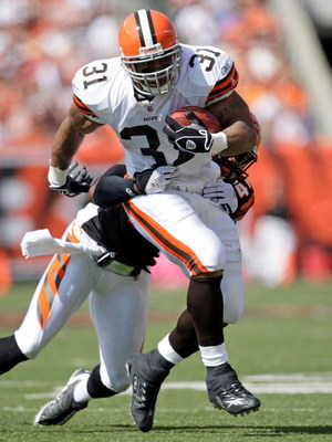 CINCINNATI - SEPTEMBER 28:  Jamal Lewis #31 of the Cleveland Browns runs with the ball while defended by Chinedum Ndukwe #41 of the Cincinnati Bengals during the NFL game against on September 28, 2008 at Paul Brown Stadium in Cincinnati, Ohio.  (Photo by