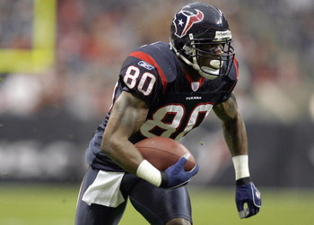 HOUSTON - DECEMBER 24:  Andre Johnson #80 of the Houston Texans carries the ball during the game against the Indianapolis Colts on December 24, 2006 at Reliant Stadium in Houston, Texas. The Texans defeated the Colts 27-24. (Photo by Chris Graythen/Getty