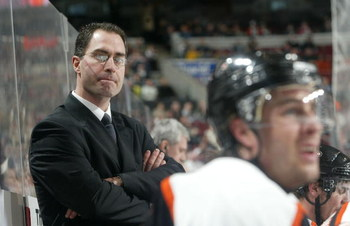 PHILADELPHIA - JANUARY 30:  Head coach John Stevens of the Philadelphia Flyers looks on against the Tampa Bay Lightning on January 30, 2007 at the Wachovia Center in Philadelphia, Pennsylvania. The Lightning defeated the Flyers 4-3 in a shoot out.  (Photo
