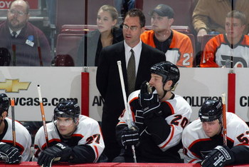 PHILADELPHIA - NOVEMBER 2:  Head coach John Stevens of the Philadelphia Flyers looks on from behind the bench against the Tampa Bay Lightning on November 2, 2006 at the Wachovia Center in Philadelphia, Pennsylvania.  The Lightning won 5-2.  (Photo by Chri