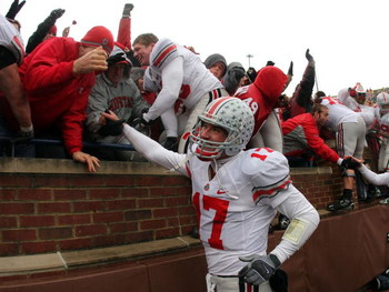 ANN ARBOR, MI - NOVEMBER 17:  Todd Boeckman #17 of The Ohio State Buckeyes celebrate a 14-3 victory over the Michigan Wolverines with fans after the fourth quarter at Michigan Stadium on November 17, 2007 in Ann Arbor, Michigan.  (Photo by Harry How/Getty