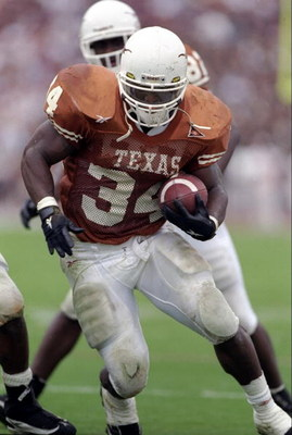 27 Nov 1998: Running back Ricky Williams #34 of the Texas Longhorns in action during the game against the Texas A&M Aggies at the Memorial Stadium in Austin, Texas. The Longhorns defeated the Aggies 26-24.
