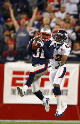 FOXBORO, MA - OCTOBER 20: Darrell Jackson #82 of the Denver Broncos has a pass intended for him intercepted by Brandon Meriweather #31 of New England Patriots at Gillette Stadium on October 20, 2008 in Foxboro, Massachusetts. (Photo by Jim Rogash/Getty Im