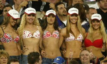 SYDNEY - OCTOBER 6:  Swimsuit fans including Jennifer Hawkins of Australia (second from right who went on to become Miss Universe 2004) show their wares during the 2002 NRL Grand Final played between the Sydney Roosters and the New Zealand Warriors held a