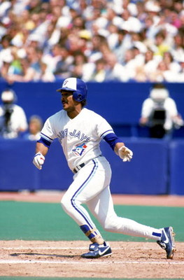 TORONTO - 1990:  George Bell #11 of the Toronto Blue Jays swings at a pitch during a 1990 game at Skydome in Toronto, Ontario, Canada. (Photo by Rick Stewart/Getty Images)