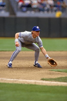 OAKLAND, CA - 1990:  Kelly Gruber #17 of the Toronto Blue Jays readies for a play as he fields his position during a game against the Oakland Athletics in 1990 at Oakland-Alameda County Coliseum in Oakland, California.  (Photo by Otto Greule Jr/Getty Imag