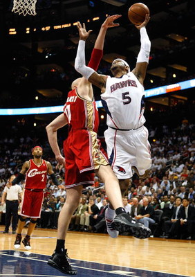 ATLANTA - MAY 11:  Josh Smith #5 of the Atlanta Hawks goes up for a shot against Zydrunas Ilgauskas #11 of the Cleveland Cavaliers during Game Four of the Eastern Conference Semifinals during the 2009 NBA Playoffs at Philips Arena on May 11, 2009 in Atlan