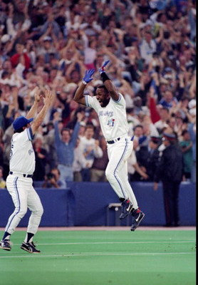 23 Oct 1993:  Firrst baseman Joe Carter of the Toronto Blue Jays celebrates after a home run in the ninth inning during the World Series against the Philadelphia Phillies at the Toronto Sky Dome in Toronto, Canada. Mandatory Credit: Rick Stewart  /Allspor