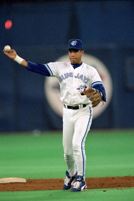 TORONTO - OCTOBER 17:  Roberto Alomar #12 of the Toronto Blue Jays throws the ball during game 2 of the World Series against the Philadelphia Phillies at the SkyDome in Toronto, Ontario, Canada, on October 17, 1993.  The Phillies won 6-4. (Photo by Rick S