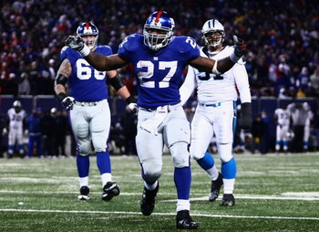 EAST RUTHERFORD, NJ - DECEMBER 21:  Running back Brandon Jacobs #27 of the New York Giants celebrates in the end zone after scoring a touchdown against the Carolina Panthers on December 21, 2008 at Giants Stadium in East Rutherford, New Jersey.  (Photo by