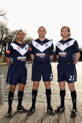 MELBOURNE, AUSTRALIA - JULY 24:  Archie Thompson, Kevin Muscat and Nick Ward of the Victory pose during the Melbourne Victory A-League television commercial shoot at Albert Park Lake on July 24, 2009 in Melbourne, Australia.  (Photo by Robert Cianflone/Ge