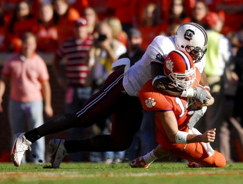 CLEMSON, SC - NOVEMBER 25:  Jasper Brinkley #52 of the South Carolina Gamecocks sacks quarterback Will Proctor #14 of the Clemson Tigers during an NCAA football game at Memorial Stadium November 25, 2006 in Clemson, South Carolina. South Carolina won 31-2