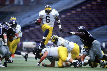 7 Nov 1992: MICHIGAN RUNNING TYRONE WHEATLEY BACK LEAPS OVER THE LINE OF SCRIMMAGE DURING THE WOLVERINES GAME AT THE NORTHWESTERN WILCATS IN EVANSTON, ILLINOIS.