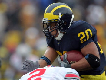 ANN ARBOR, MI - NOVEMBER 17:  Mike Hart #20 of the Michigan Wolverines is hit by Malcolm Jenkins #2 of The Ohio State Buckeyes during the third quarter at Michigan Stadium on November 17, 2007 in Ann Arbor, Michigan.  The Buckeyes won 14-3.  (Photo by Har