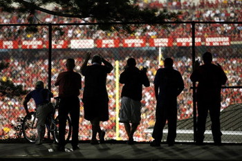 COLLEGE PARK, MD - SEPTEMBER 13:  Fans watch the action from outside the stadium during the game between the West Virginia Mountaineers and the Maryland Terrapins on September 13, 2007 at Byrd Stadium in College Park, Maryland.  (Photo by Jamie Squire/Get