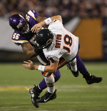 MINNEAPOLIS - DECEMBER 17: E.J. Henderson #56 of the Minnesota Vikings hits Kyle Orton #18 of the Chicago Bears after a pass at the Hubert H. Humphrey Metrodome on December 17, 2007 in Minneapolis, Minnesota. (Photo by Jonathan Daniel/Getty Images)