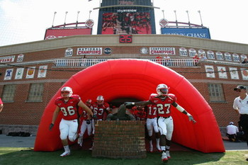 COLLEGE PARK, MD - SEPTEMBER 17:  Players from the University of Maryland Terrapins touch a turtle statue as they enter the field prior to a game against West Virginia University Mountaineers at Byrd Stadium on September 17, 2005 in College Park, Maryland