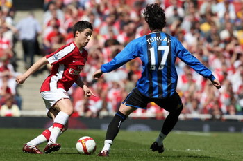 LONDON - APRIL 26:  Samir Nasri of Arsenal battles for the ball with Tuncay Sanli  of Middlesbrough during the Barclays Premier League match between Arsenal and Middlesbrough at Emirates Stadium on April 26, 2009 in London, England.  (Photo by Hamish Blai