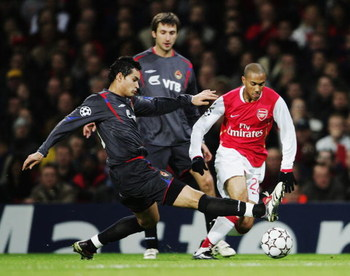 LONDON - NOVEMBER 01:  Dudu (L) of CSKA Moscow tackles Gael Clichy (R) of Arsenal during the UEFA Champions League Group G match between Arsenal and CSKA Moscow at The Emirates Stadium on November 1, 2006 in London, England.  (Photo by Phil Cole/Getty Ima