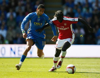 PORTSMOUTH, UNITED KINGDOM - MAY 02:  Nadir Belhadj of Portsmouth battles with Bacary Sagna of Arsenal during the Barclays Premier League match between Portsmouth and Arsenal at Fratton Park on May 2, 2009 in Portsmouth, England.  (Photo by Paul Gilham/Ge