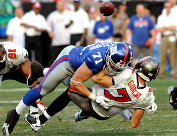 TAMPA, FL - JANUARY 06:  Defensive end Dave Tollefson #71 of the New York Giants sacks quarterback Jeff Garcia #7 of the Tampa Bay Buccaneers during the NFC Wild Card game at Raymond James Stadium on January 6, 2008 in Tampa, Florida.  The Giants won the