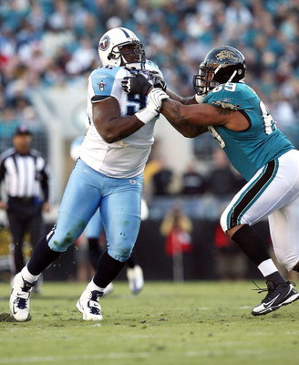 JACKSONVILLE, FL - NOVEMBER 16:  Offensive lineman Khalif Barnes #69 of the Jacksonville Jaguars tries to stop defensive lineman Albert Haynesworth #92 of the Tennessee Titans at Jacksonville Municipal Stadium on November 16, 2008 in Jacksonville, Florida