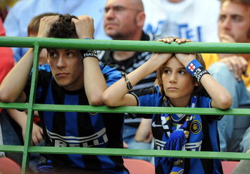 MILAN, ITALY - MAY 11:  Disappointed fans of Inter look at the Serie A match between Inter and Siena at the Stadio San Siro on May 11, 2008 in Milan, Italy.  (Photo by New Press/Getty Images)