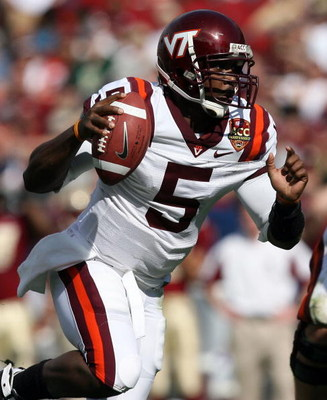 TAMPA, FL - DECEMBER 06:  Quarterback Tyrod Taylor #5 of the Virginia Tech Hokies runs for a touchdown in the first quarter against the Boston College Eagles in the 2008 ACC Football Championship game at the Raymond James Stadium on December 6, 2008 in Ta