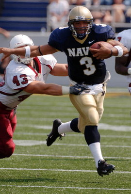 ANNAPOLIS, MD - SEPTEMBER 9:  In this handout provided by the U.S. Navy, Quarterback Brian Hampton of the Navy Midshipmen outpaces linebacker Jason Hatchell of the Massachusetts Minutemen in the first half of play on September 9, 2006 at Navy Memorial Sta