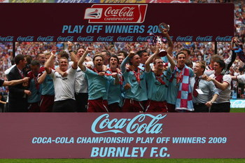 LONDON - MAY 25:  Burnley players celebrate victory with the trophy during the Coca-Cola Championship Playoff Final between Burnley and Sheffield United at Wembley Stadium on May 25, 2009 in London, England.  (Photo by Jamie McDonald/Getty Images)
